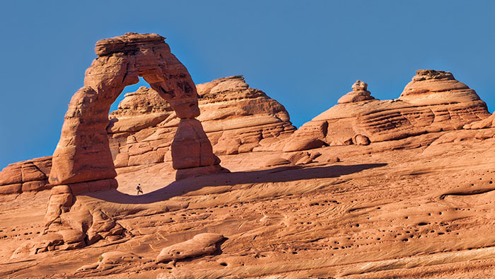 Delicate Arch, man beneath arch, Arches National Park, Utah