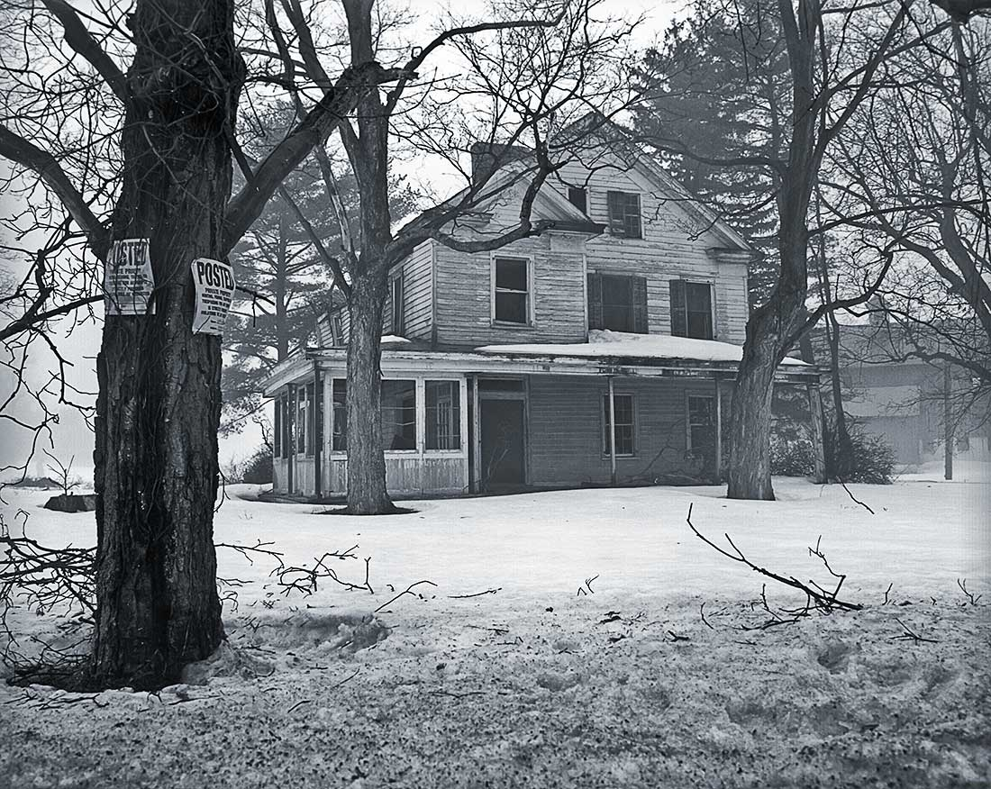 Winter storm and old house