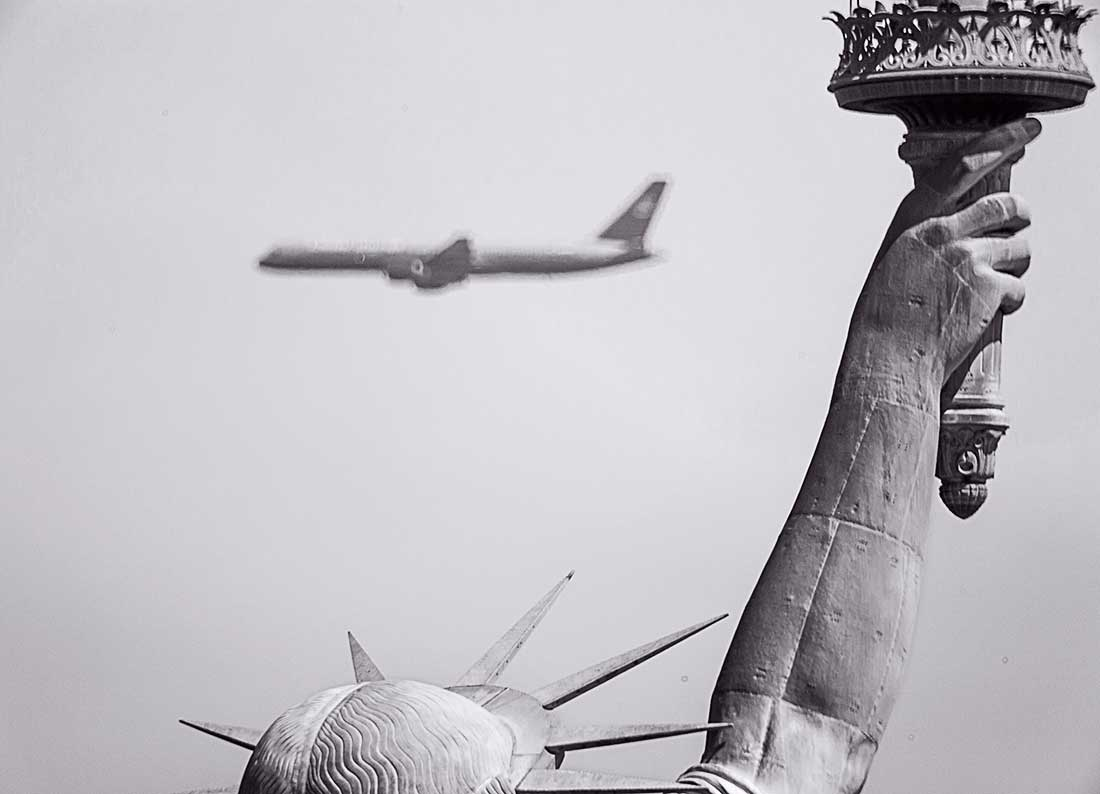State of Liberty and commercial jet.