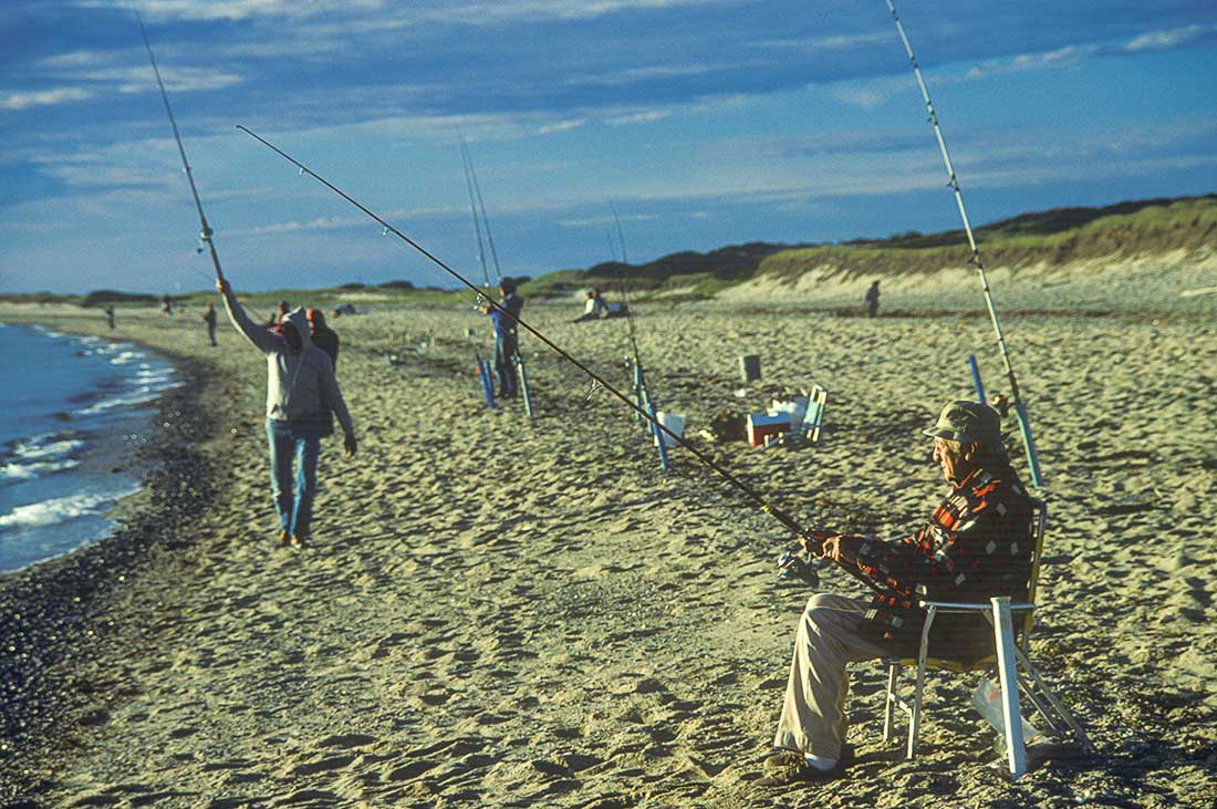 Men fishing at Herring Cover Beach, Provinceton, Cape Cod.