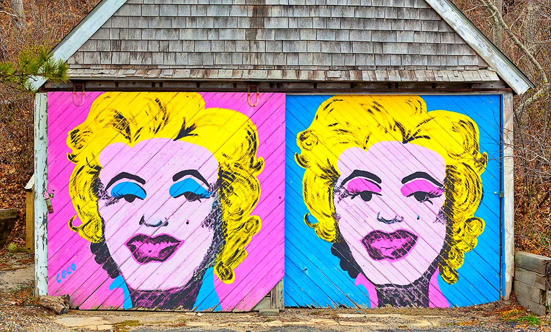 Marilyn Monroe painting on old garage doors.
