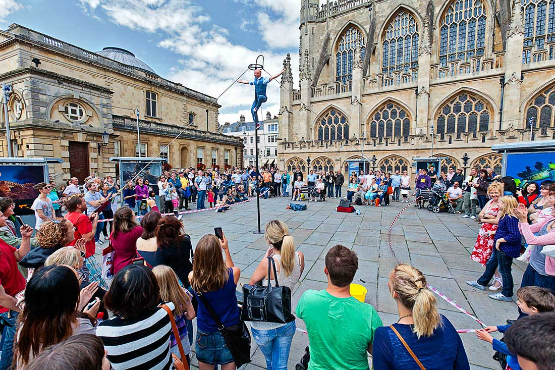 Street performer in front of the  Bath Abbey, Bath Spa, England.
