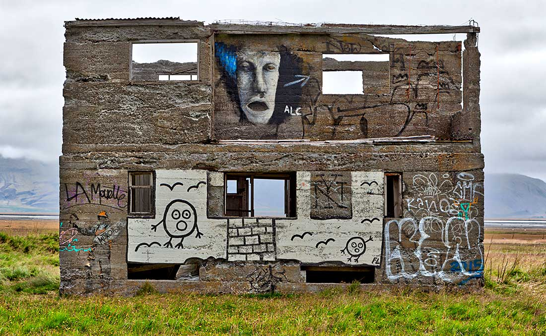 Graffiti artwork on abandoned building, Iceland.