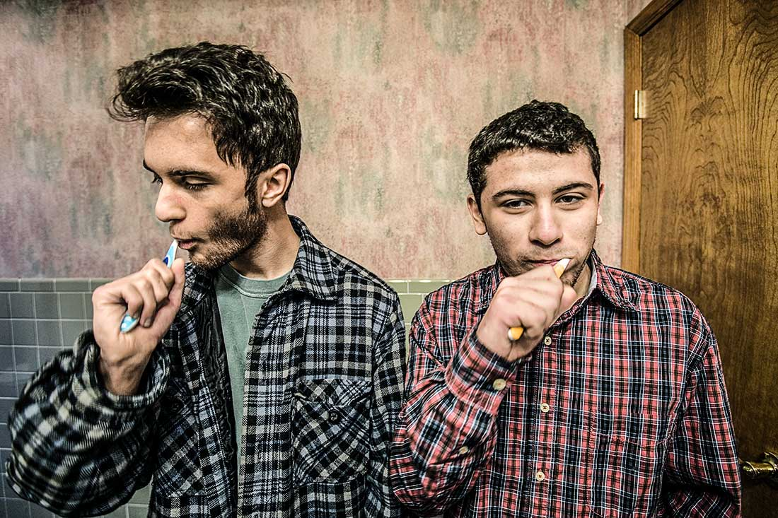 Two Young Men Brushing Teeth.
