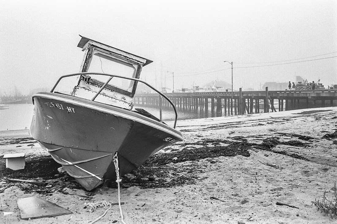 Abandoned small boat on beach.