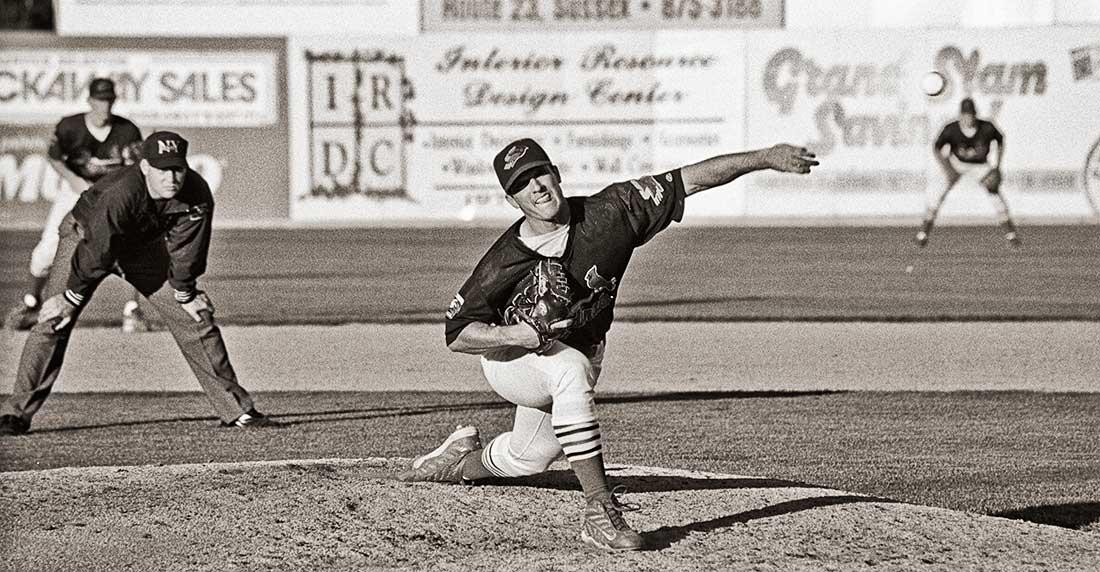 Baseball pitcher pitching baseball.