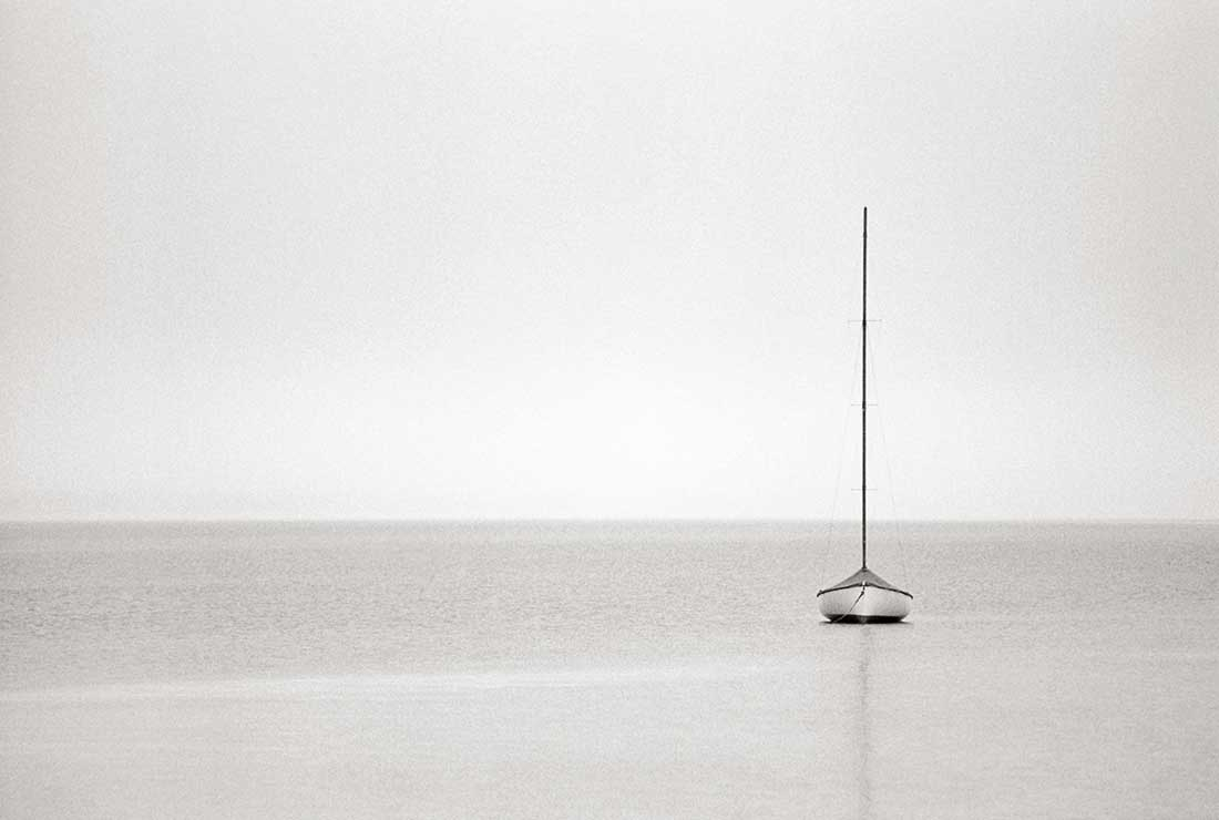 Solo boat on water.