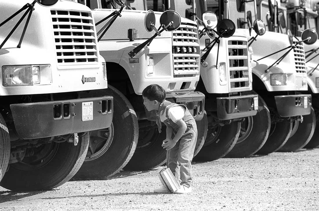 Young boy looking at School Bus
