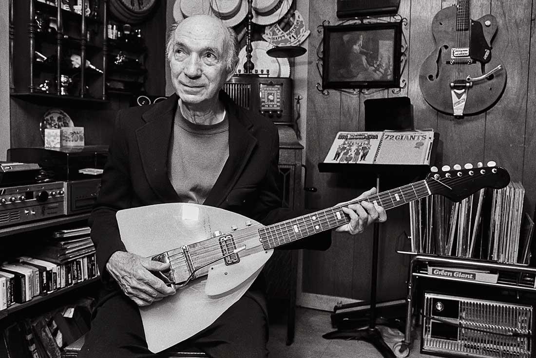 Elderly man playing guitar