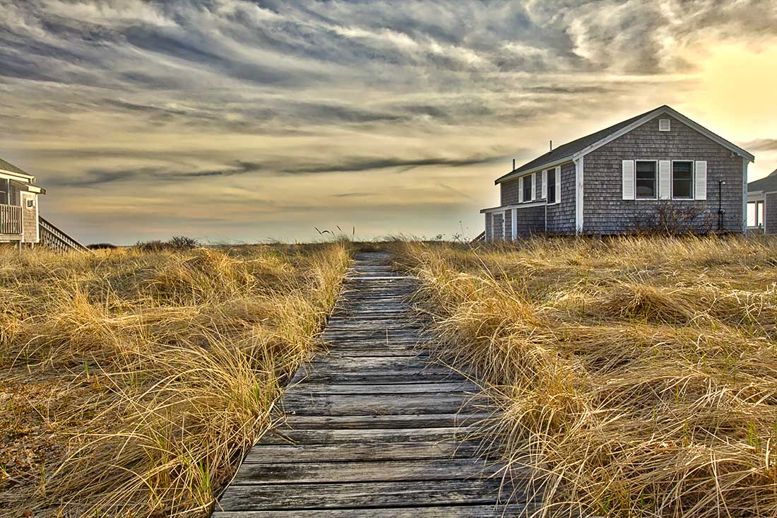 Sunrise over cottage, Provincetown, Cape Cod.