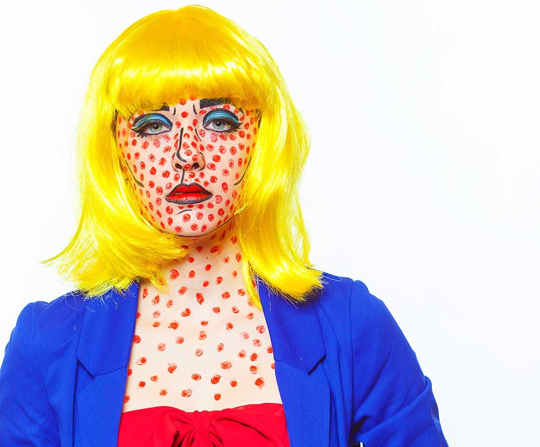 A young lady dressed like a Roy Lichtenstein painting at the Comic Con Convention.