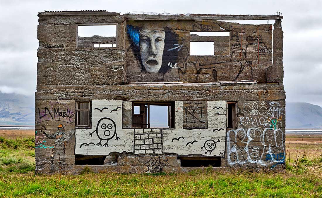 Graffiti artwork on abandoned building, Iceland.