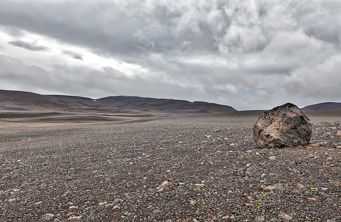 A boulder on a lifeless plain in northern Iceland