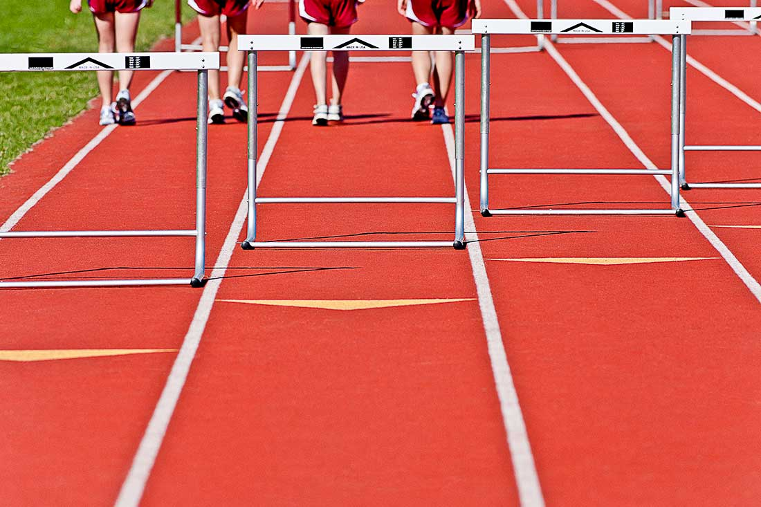 Four runners walking during Track and Field.