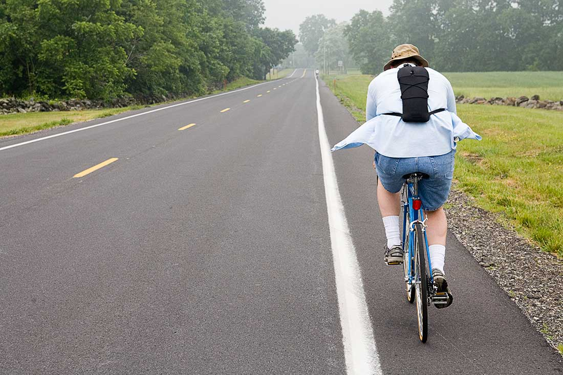 A Bike Rider on the road.
