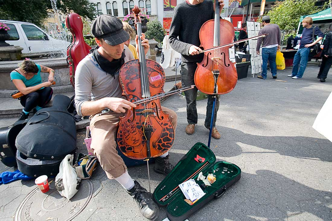 Street musicians playing music in New York City.